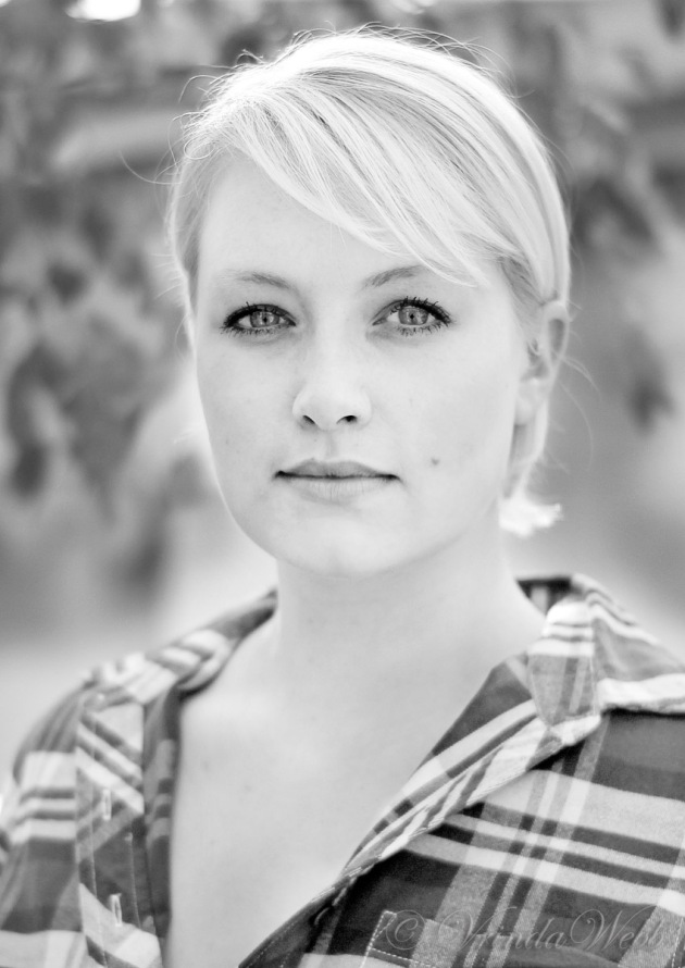 black and white headshot of Sophie facing the camera straight-on