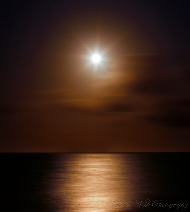 The moon bright over the sea.