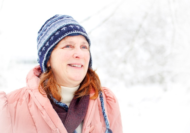 In the snow with blue hat