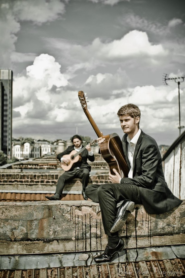 Jiva Housden and Dan Bovey, guitarists, on rooftop in London